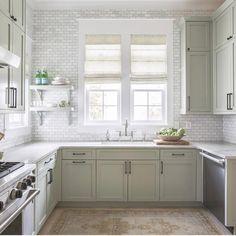 Marble tile backsplash, sheer linen romans, marble countertops, green gray cabinets, black hardware, polished nickel faucet, a little open shelving, killer neutral Turkish rug