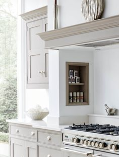 This grey and white kitchen shows a contemporary take on a traditional shaker style kitchen, featuring exposed oak storage solutions. Kitchen Mantle, Kitchen Chimney, Home Decor Kitchen, Interior Design Kitchen, Interior Livingroom, Shaker Style Kitchens, Shaker Kitchen, Home Kitchens, European Kitchens