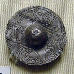 Lead-alloy disk brooch. Urnes style, ca. 1026-1075. British Museum.  viking