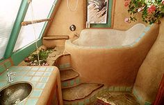 "Gorgeous bathroom from inside an ""Earthship"" home - LOVE the natural feel and turquoise tiles! And that huuuge bathtub!"