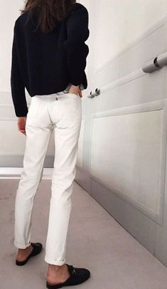 dark knit, white jeans and open-back mule loafers