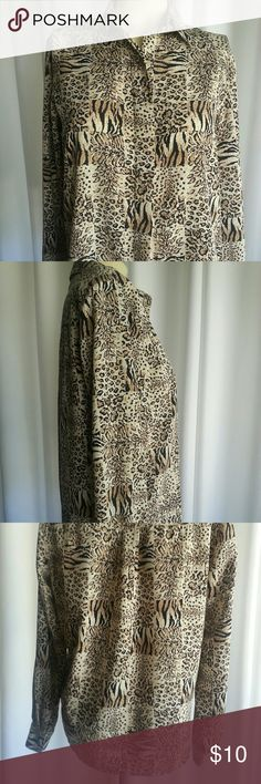 """Afred Dunner Animal Print long sleeve blouse 6P Size 6 petite  Alfred Dunner collared long sleeved, dressy button (hidden) down blouse. 6 different black, cream & brown animal print squares throughout blouse. Button down, double stitched front to hide buttons with 6"""" slits on sides of blouse at botton hem. Printed buttons at cuffs & at top collar. 100% polyester. Pre-owned in good condition.  Pit to pit 20.5"""" Bottom of pit to hem 15"""" Alfred Dunner Tops"""