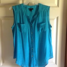 Sleeveless turquoise colored top. Never worn, lightweight pretty top. Can be tucked in or tied or the bottom. AB Studio Tops