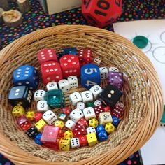 EY2P training  ... Raising Attainment in Maths in Nursery... a big basket of lots of different types of dice.... use initially as a focus activity .... lots of opportunities to experiment and talk about numbers and make up their own games! Then leave for child initiated play and then put in maths area for them to use in their problem solving and game playing! LH