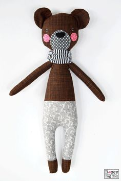 :: eco friendly doll :: intricately hand sewn features :: approximately 15 inches tall :: new and repurposed fabric  Introducing Berkeley Bear! This is the friendliest bear you ever did see, dressed to impress in his go-to-meetin clothes. Hes tall and thin, and from his toes to is chin, and up to the tips of his ears hes pleased to be there for you. He may live in a cave, but hes quite gentlemanly. Id say hed be up for a tea party! This guy is a-okay, so hows about you make a new friend…