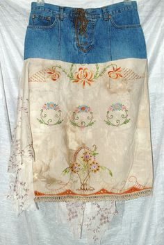 Denim skirt with vintage embroidered pillowcase.  I'd make the denim portion into a V-yoke for extra effect.