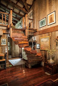 Photo Credit: Hollis Bennett. A self-supporting staircase includes a brass casket handle for a railing.