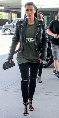 Kim Kardashian dons her hubby's Yeezus tee with super skinny tattered black denim for a rebel look with sophistication. // #Fashion