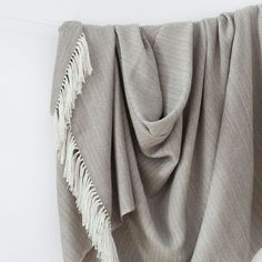 Wrap up in our thickest, most luxurious alpaca blanket. A modern take on traditional patterns, this piece features a herringbone pattern in an oatmeal hue.