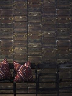 Luggage Wallpaper A richly textured wallpaper design featuring stacks of old fashioned suitcases.