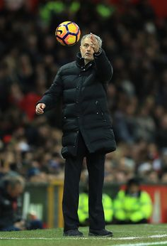 Jose Mourinho Manager of Manchester United catches the ball during the Premier League match between Manchester United and Tottenham Hotspur at Old...