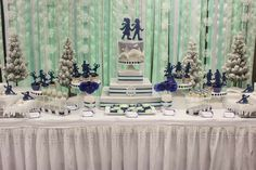 Stunning dessert table at a winter wonderland ice skating birthday party! See more party planning ideas at CatchMyParty.com!