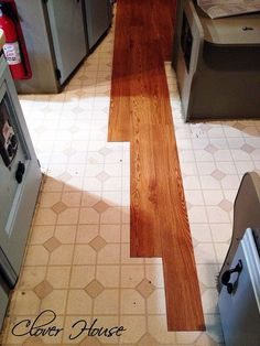 rv remodel on a budget floor update, flooring, home improvement, We used a staggered look to lay the new tiles Very time consuming but worth it