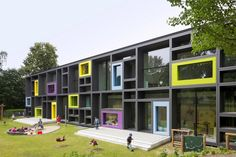 Children's day care centre for 7 groups ADDED VALUE The colourful facade frames are a characteristic feature of the new kindergarten on the outside and a means to provide varied space for creative play inside. The two-storey new build is. Architecture Design, Education Architecture, Facade Design, Exterior Design, Kindergarten Projects, Kindergarten Design, Kindergarten Lesson Plans, Kindergarten Architecture, Building Facade