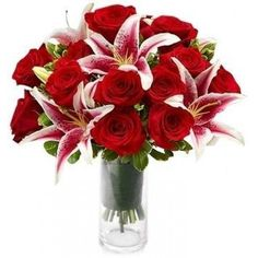 contemporary bouquet of gorgeous red roses and elegant pink lilies.The sweet, gentle fragrance of this flower creates a feeling of tranquility. Elegant #Flowers Arrangement For #Bahrain .