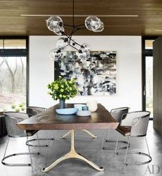 SIGNATURE DESIGN FURNITURE |  Jim Zivic chairs from Ralph Pucci International join a BDDW table beneath a Lindsey Adelman Studio light fixture in the dining area. | bocadolobo.com/ #limitededitionfurniture  #luxuryfurniture #exclusivedesign #designideas