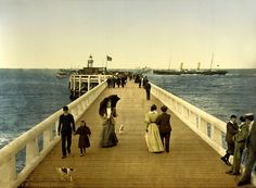 "The Pier. Ostend, Belgium. 1895. ""Chloe felt faint. Her face tingled with cold sparks. She sat down on a footstool. She was going to Ostend. To see her grandmother. And they were leaving for the city tonight. This very evening. And she would be going with Simon. This man. Her mind flashed with the image of his hands separating her thighs. Her husband. 'I didn't have a chance to tell you. I would like to take you home.'"" (Swann Bay, GiuliaTorre.com, 2015)."