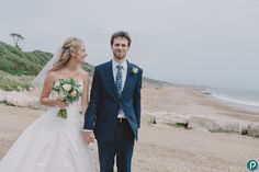 Bride and Groom on the beach at Highcliffe, Dorset - candid wedding portrait