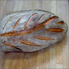 Leaf pattern, scored with precision and control. Photo snapped inside Christophe Moussu's bread lab at Ferrandi in Paris, France, a training ground for professional bread bakers. Photo by MC Farine ([@]mcfarine), posted with her permission.