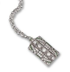 DIAMOND & EMERALD PENDANT-BROOCH & CHAIN, CIRCA 1925.  The rectangular pendant set with a row of 5 round diamonds bordered by numerous old European-cut & single-cut diamonds, the sides accented with bands of calibré-cut emeralds, mounted in platinum, supported on a platinum chain of diamond-set navette & circular links, length 28 inches, pendant may be worn separately as a brooch