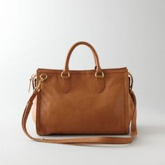 fa98c3b1de Edge trimmed satchel with leather handles and detachable shoulder strap.  Main compartment with two inside