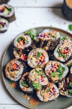Healthy veggie rainbow sushi rolls with a creamy tamari almond butter sauce to dip. Making your own sushi rolls is a lot easier than you think! Vegan Sushi Rolls, Sushi Roll Recipes, Veggie Recipes, Asian Recipes, Whole Food Recipes, Vegetarian Recipes, Cooking Recipes, Healthy Recipes, Easy Sushi Rolls