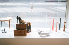 Chick Table by Maria Rästa, Shoes by Sofie Bly, Wooden Boxes from House Doctor.  photo: Hey Look / Michaela Egger