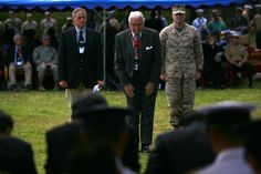 Retired Lt. Gen. Lawrence F. Snowden pays respect by bowing to the official Japanese party prior to giving his speech during the 67th Iwo Jima Reunion of Honor ceremony. The Battle of Iwo Jima lasted for 36 days and resulted in nearly 30,000 lives lost from both nations. This ceremony gave both countries the opportunity to honor the service members who lost their lives 67 years ago. (DVIDS photo by Cpl. Justin Wheeler. Used with permission.)
