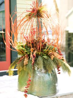 Upside Down Arrangement:   The base of this arrangement is a ceramic pot turned upside-down, which protects the container for winter and serves as a pedestal for the arrangement