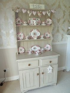 This solid old pine welsh dresser has been hand painted with Annie Sloan Country Grey paint, distressed to give it a worn country feel and then waxed for protection. Lovely neutral colour which would suit many colour schemes. The dresser offers two shelves to display all your favourite items, along with lots of handy storage space with two draws and two cupboards underneath.