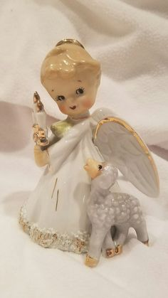 Very cute angel bell with lamb and candle. She is 5 inches tall and in great condition. Any questions please ask. Check out my other auctions | eBay!