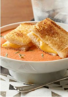 Tomato-Basil Soup with Grilled Cheese -- Creamy, cheesy tomato basil soup tastes even better when it's served with America's favorite grilled sandwich recipe, grilled cheese!