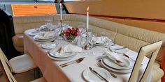 Enjoy your one-of-a-kind candle lit dinner aboard the Alexandros Ferretti 680 by Sunset Oia Sailing Cruises