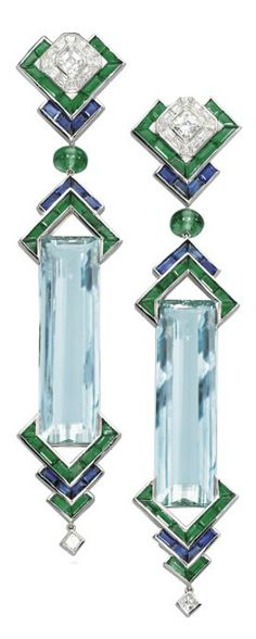 A PAIR OF UNIQUE AQUAMARINE, EMERALD, SAPPHIRE AND DIAMOND EAR PENDANTS, BY PRINCE DIMITRI Of geometric design, each elongated rectangular-cut aquamarine weighing 39.44 and 37.41 carats bordered by calibré-cut emerald and sapphire arrow-shaped motifs, suspended from a diamond, sapphire and emerald similarly-designed surmount, mounted in platinum, 10.5 cm long, in a Prince Dimitri fuchsia velvet case With maker's mark for Prince Dimitri