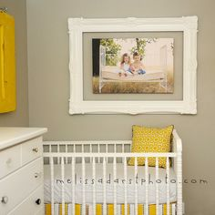frame around canvas print. You can change out the picture as the baby grows up; makes a more age adaptable baby room.