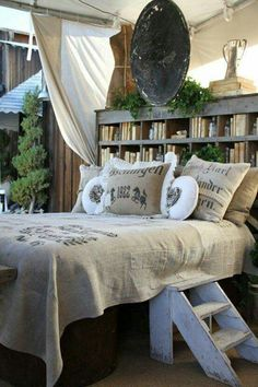 Love the bookshelf as the headboard