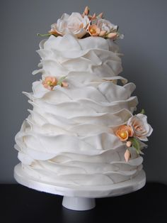 Ruffled wedding cake with pale peach sugar roses and blossoms from the Handmade Cake Company