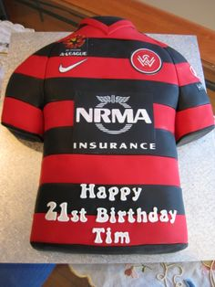 For the soccer fan on his 21st. Western Sydney Wanderers jersey sculpted from chocolate cake and covered in fondant.