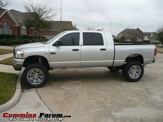 Silver Grey Lifted Dodge Ram Truck