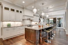 Expansive Edina Craftsman by Donnay Homes - love the way the ceiling meets the cabinets