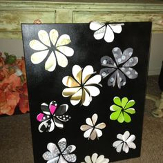 Canvas spray painted black, gift bags from our wedding gifts cut into hearts and made into flowers...
