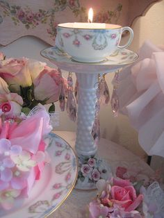 I love this...teacup and saucer on a candle holder with crystals hanging...so pretty