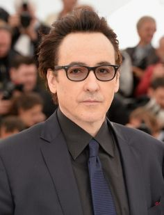 0b305c2700 John Cusack wearing Ray-Ban Liteforce style RB4207 601S 9A with  prescription lenses while
