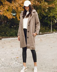We are a huge fan of the cozy teddy bear coats! And we think the best way to complete your fall outfits is to mix trendy pieces with your casual athleisure pieces! A leather baseball hat + sneakers dresses down a more chic look! // Hat $12.50 // Coat $98.00 // Sweater $56.50 // Leather leggings $54.50 | Primp Boutique | White Bear Lake, Teddy Bear Coat, Dress With Sneakers, Baseball Hat, Winter Is Coming, Leather Leggings, Sweater Weather, Athleisure, Fall Outfits