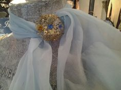 Beautiful baby blue chiffon scarf £6 and golden brooch with blue stones £10. For sale in store only,