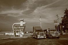 Route 66 - Rest Haven Motel and big rigs, Springfield, Missouri.