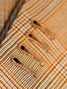 This tutorial on handmade buttonholes is great!