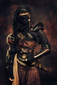 head shroud, mechanical arm, sword, belts (multiples for items) poofy pants, gear accents Steam punk ninja assassin!