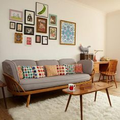 We love the cheerful interplay of a kooky gallery wall and an array of vintage-y patterned pillows.
