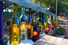 Here are 60 creative DIY glass bottle ideas for outdoor living spaces. From bottle trees to bottle walls, recycled glass bottles become outdoor art. Outdoor Garden Lighting, Outdoor Chandelier, Outdoor Light Fixtures, Chandelier Ideas, Round Chandelier, Farmhouse Chandelier, Chandelier Lighting, Lighted Wine Bottles, Bottle Lights
